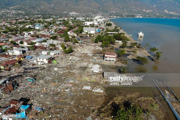 TOPSHOT An aerial view shows the earthquake and tsunami devasted neighbourhood in Palu Indonesia's Central Sulawesi on October 1 2018 The death toll...