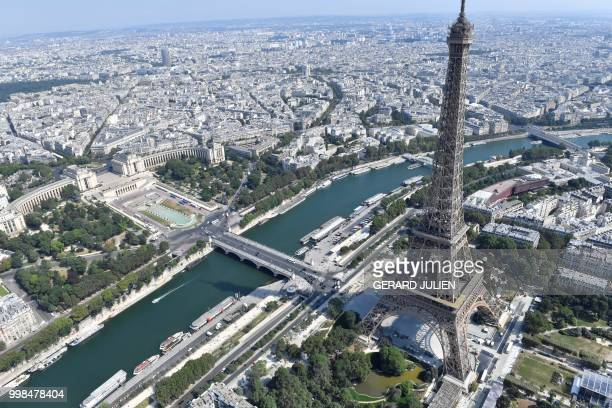 An aerial view shows the Eiffel tower by the river Seine during the annual Bastille Day military parade on the ChampsElysees avenue in Paris on July...