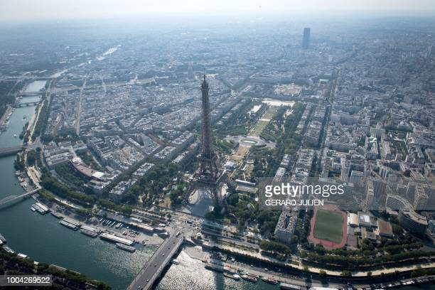 TOPSHOT An aerial view shows the Eiffel tower by the river Seine in Paris on July 14 2018