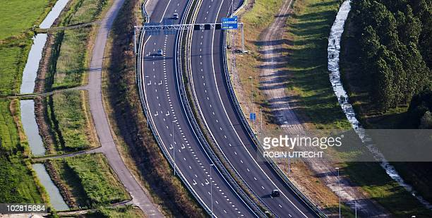 An aerial view shows the empty highway A9 next to Amsterdam during the viewing of the 2010 World Cup football match final between Spain and the...