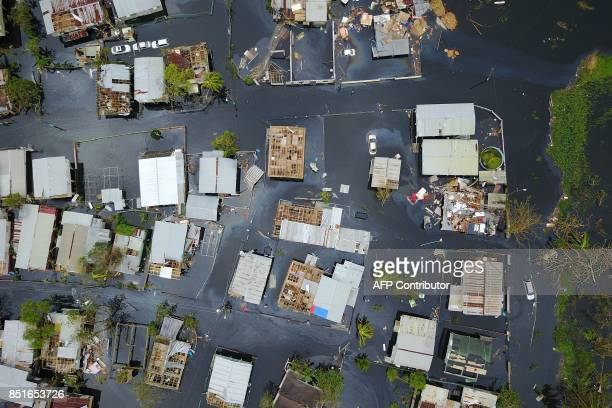 An aerial view shows the flooded neighbourhood of Juana Matos in the aftermath of Hurricane Maria in Catano Puerto Rico on September 22 2017 Puerto...