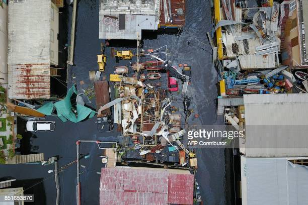 An aerial view shows the flooded neighbourhood of Juana Matos in the aftermath of Hurricane Maria in Catano, Puerto Rico, on September 22, 2017....