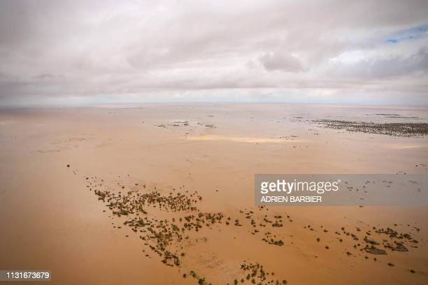 An aerial view shows the flooded plane surrounding Beira, central Mozambique, on March 20 after the passage of cyclone Idai. - International aid...