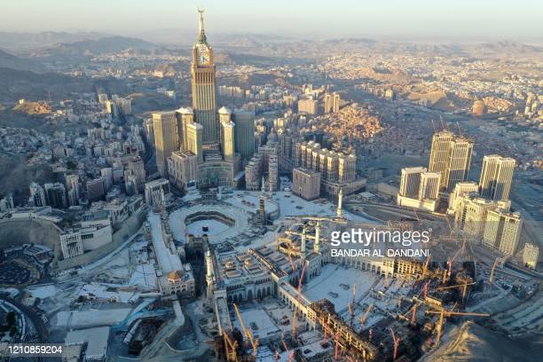 An aerial view shows the Grand Mosque and the Mecca Tower deserted on the first day of the Muslim fasting month of Ramadan in the Saudi holy city of...