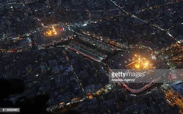 An aerial view shows the Imam Hussein shrine and Imam Abbas shrine as Iraqi Shiites take part in commemorations during the mourning period of...