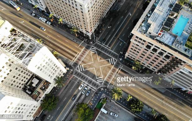 An aerial view shows the intersection of Hollywood and Vine, shortly before sunset, with lighter than normal traffic as the coronavirus pandemic...