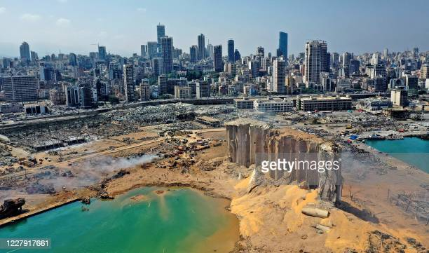 An aerial view shows the massive damage at Beirut port's grain silos and the area around it on August 5 one day after a massive explosion hit the...