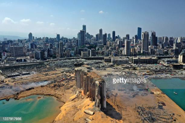 An aerial view shows the massive damage done to Beirut port's grain silos and the area around it on August 5 one day after a megablast tore through...