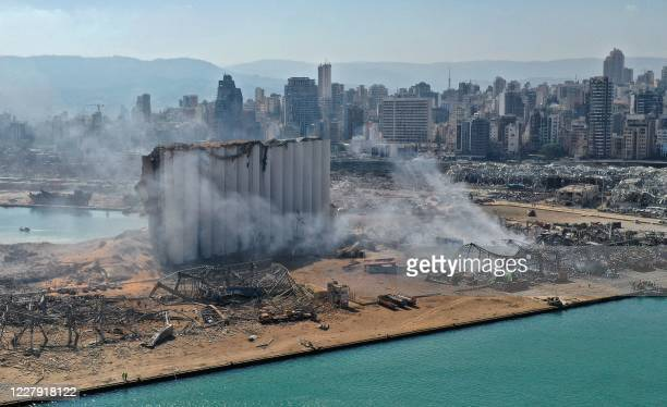 TOPSHOT An aerial view shows the massive damage done to Beirut port's grain silos and the area around it on August 5 one day after a megablast tore...