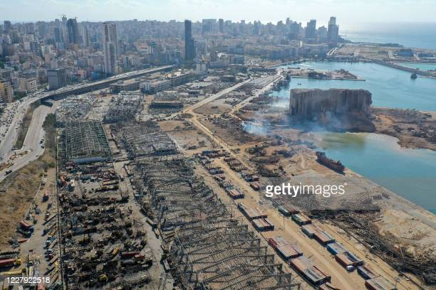 An aerial view shows the massive damage done to Beirut port's grain silos and the area around it on August 5 one day after a mega-blast tore through...