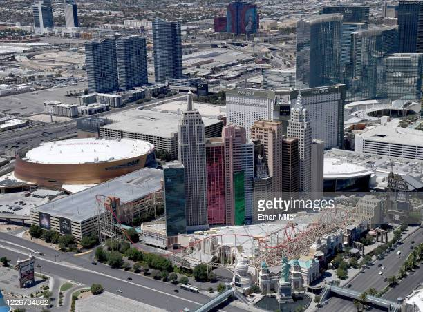 An aerial view shows the New YorkNew York Hotel Casino and TMobile Arena home of the NHL's Vegas Golden Knights both of which have been closed since...