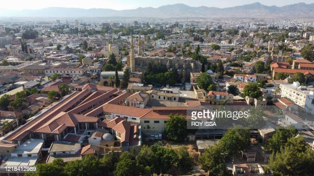An aerial view shows the northern part of Nicosia in the self-declared Turkish Republic of Northern Cyprus with the Buyuk Han and landmark Selimiye...