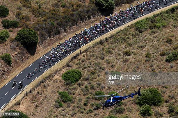 An aerial view shows the pack riding during the 1455 km third stage of the 100th edition of the Tour de France cycling race on July 1 2013 between...