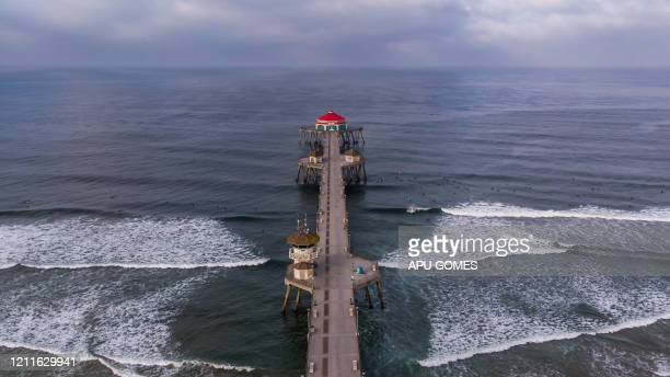 TOPSHOT An aerial view shows the pier in Huntington Beach California on May 02 2020 Orange County beaches will remain closed after a California...