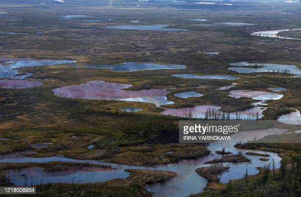 An aerial view shows the pollution in a river outside Norilsk on June 6 2020 Russian President Vladimir Putin on June 3 ordered a state of emergency...