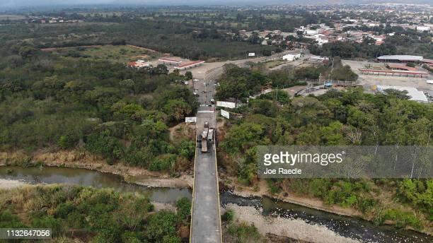 An aerial view shows the remains of burnt out aid relief trucks on the Francisco de Paula Santander International Bridge which connects Cúcuta with...