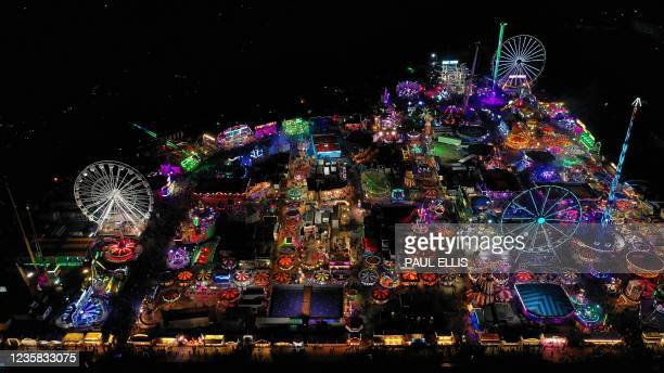 An aerial view shows the rides and stalls at the Hull Fair on October 11, 2021. - The Hull Fair, one of Europe's largest travelling fairs, returned...