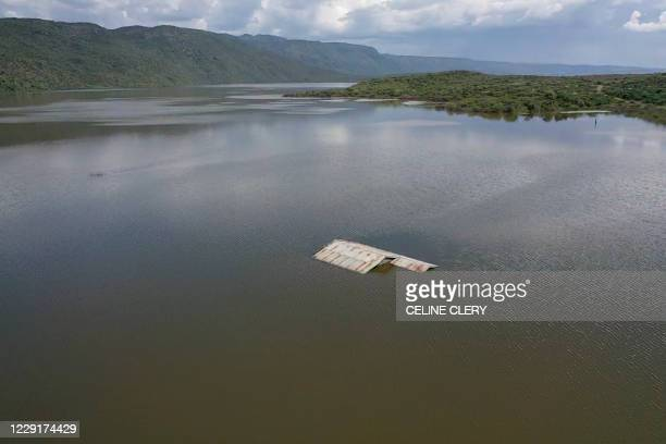 An aerial view shows the rising water levels at the caustic lake in Lake Bogoria National Reserve that have now almost completely inundated the...