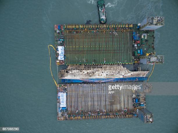 TOPSHOT An aerial view shows the salvage operation of the Sewol ferry off the coast of South Korea's southern island of Jindo on March 24 2017 South...