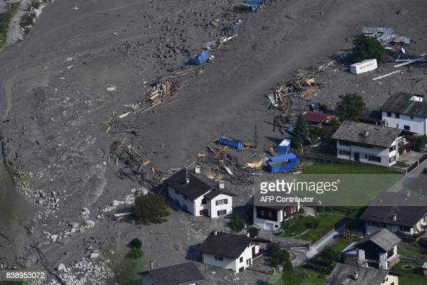 An aerial view shows the Swiss village of Bondo after another landslide on August 25 2017 Eight hikers are still missing after a massive landslide...
