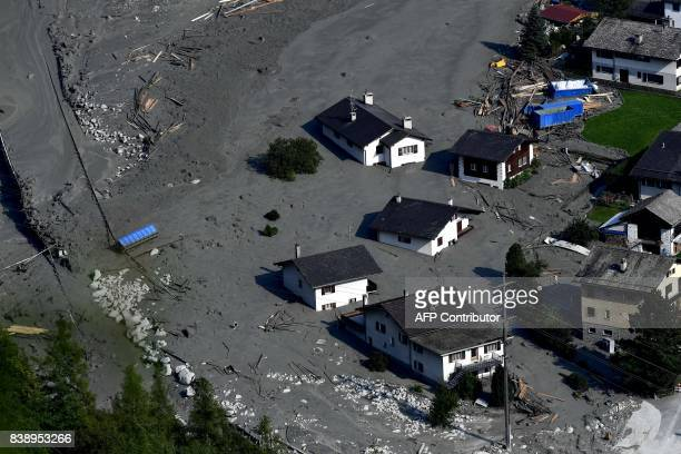TOPSHOT An aerial view shows the Swiss village of Bondo after another landslide on August 25 2017 Eight hikers are still missing after a massive...