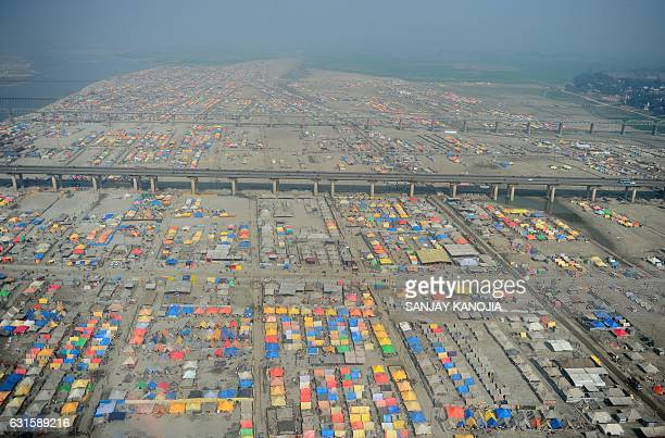TOPSHOT An aerial view shows the temporary camp set up for Hindu devotees at Sangam the confluence of the Rivers Ganges Yamuna and mythical Saraswati...