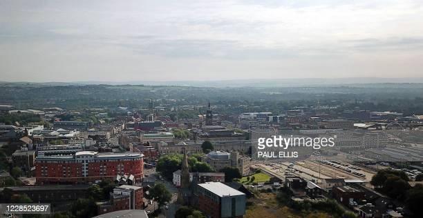 An aerial view shows the town of Bolton, in Greater Manchester in north west of England on September 15 as local lockdown restrictions are put in...