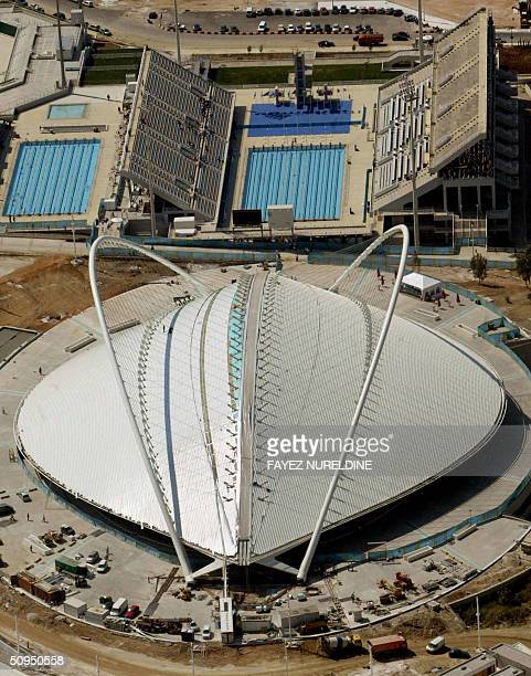 An aerial view shows the velodrome and the aquatic centre in the Athens Olympic complex 11 June 2004 The velodrome will host the cycling competition...