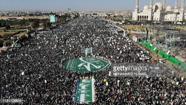 TOPSHOT An aerial view shows Yemeni Muslims attending a gathering to celebrate the birth of Islam's Prophet Mohammed in the Yemeni capital Sanaa on...