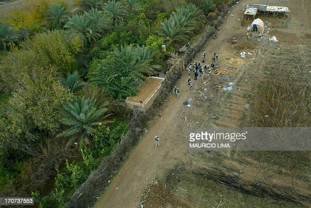 An aerial view taken 15 December 2003 shows the hut and the area around it where US soldiers from 1st Brigade of the 4th Infantry Division captured...