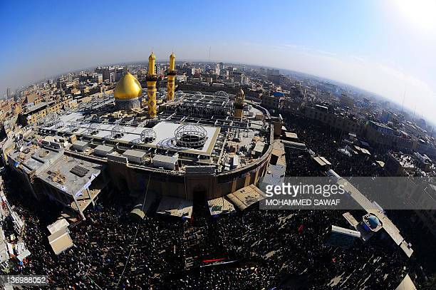 An aerial view taken by a fisheye lens shows Shiite Muslims gathering at shrine of Imam Abbas brother of Imam Hussein on January 14 2012 during the...