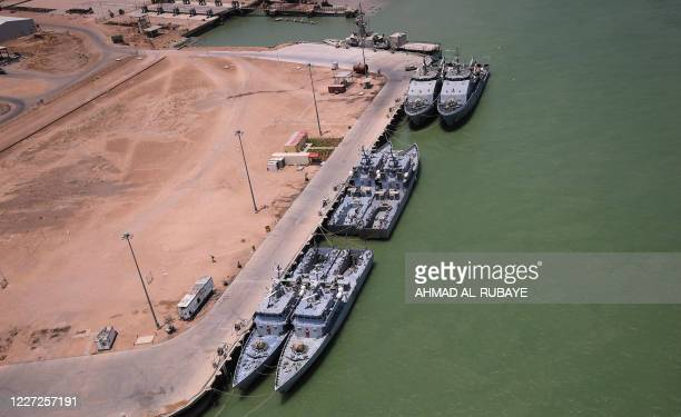 An aerial view taken during the visit of Iraqi prime minister to the southern city of Basra shows warships anchored at the port of Umm Qasr on July...