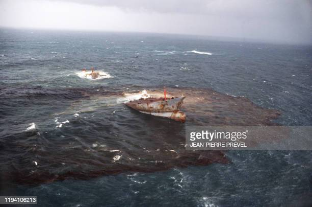 An Aerial view taken in March 1978 of the wreck of the Liberian oil tanker Amoco Cadiz which ran aground near the small port of Portsall on the coast...