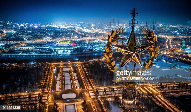 TOPSHOT An aerial view taken with a drone in Moscow on January 27 2018 shows a star on top of the Moscow State University Luzhniki Stadium and the...