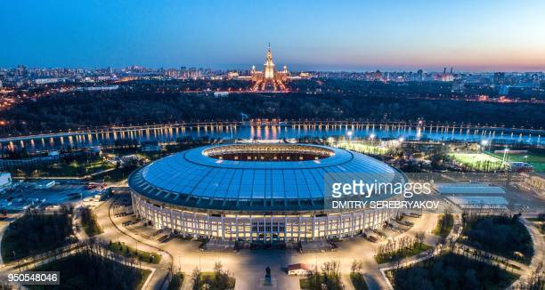 TOPSHOT An aerial view taken late on April 23 2018 shows the Luzhniki stadium and the main building of the Moscow State University in Moscow