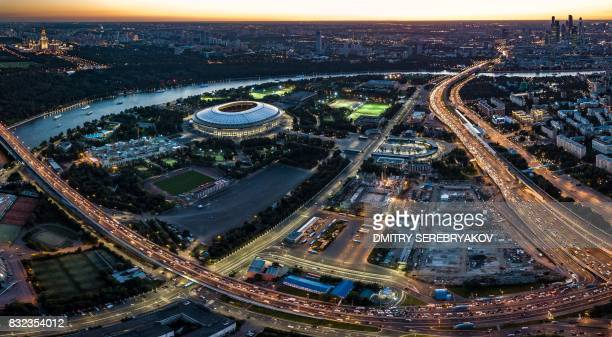 An aerial view taken late on August 15 2017 shows the Luzhniki stadium the buildings of the Moscow International Business Center and the Moscow State...
