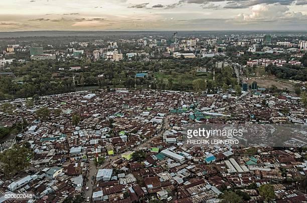 TOPSHOT An aerial view taken on April 10 2016 shows the Kibera slum in Nairobi / AFP / FREDRIK LERNERYD
