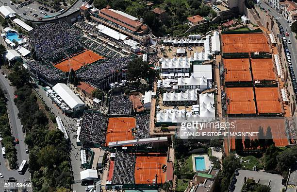 An aerial view taken on April 14 2016 shows the clay tennis courts of the MonteCarlo ATP Masters Series Tournament in Monaco AFP PHOTO / JEAN...