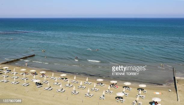An aerial view taken on August 1, 2020 shows Larnaca's Makenzy beach in the east Mediterranean island of Cyprus, a former UK colony that depends...