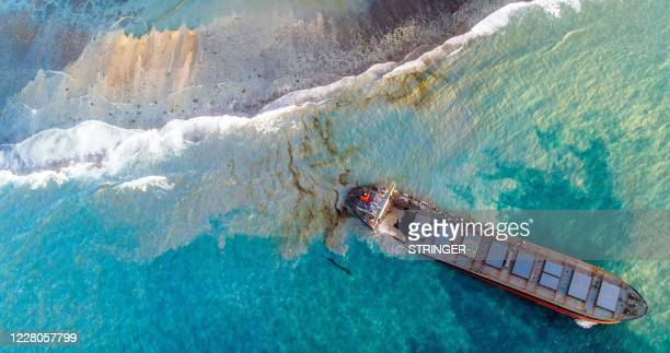 An aerial view taken on August 15, 2020 shows the vessel MV Wakashio, belonging to a Japanese company but Panamanian-flagged that had run aground...