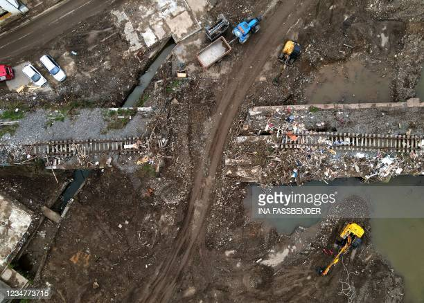 An aerial view taken on August 19, 2021 shows a destroyed railway track during clearing work in Altenahr, Rhineland-Palatinate, western Germany,...