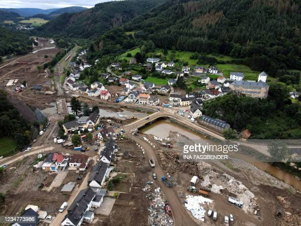 An aerial view taken on August 19, 2021 shows a landfill with debris in Altenahr, Rhineland-Palatinate, western Germany, weeks after heavy rain and...