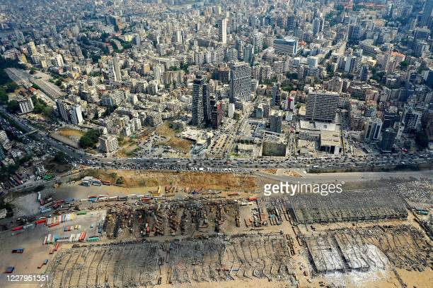 An aerial view taken on August 7 shows a partial view of the Lebanese capital Beirut and the port that was destroyed three days earlier when a huge...