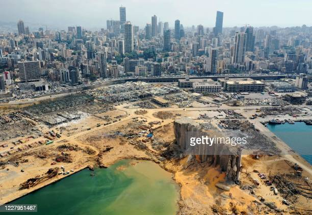 An aerial view taken on August 7 shows a partial view of the port of Beirut, the damaged grain silo and the crater caused by the colossal explosion...