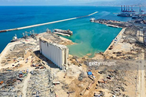 An aerial view taken on August 9 shows a general view of the port of Beirut, the damaged grain silo and the crater caused by the colossal explosion...
