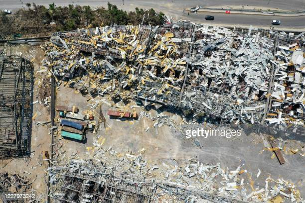 An aerial view taken on August 9 shows a partial view of the port of Beirut, damaged as a result of the colossal explosion of a huge pile of ammonium...