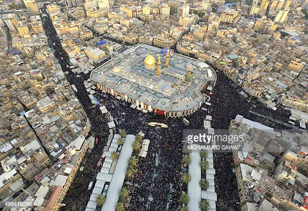 An aerial view taken on December 1 2015 shows Iraqi Shiite pilgrims gathering at the shrines of Immam Abbas ibn Ali and Imam Hussein during the...