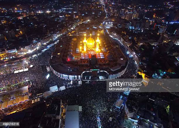 An aerial view taken on December 1 2015 shows Iraqi Shiite pilgrims gathering at the shrine of Imam Abbas ibn Ali the brother of Imam Hussein during...