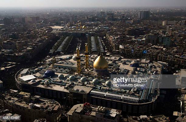 An aerial view taken on December 21 2013 shows the shrines of Shiite Muslim Imam Hussein and Imam Abbas as pilgrims gather in the central city of...