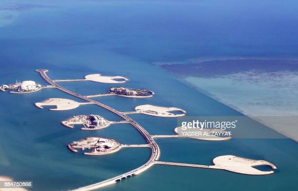 TOPSHOT An aerial view taken on December 3 shows a partial view of the PearlQatar artificial Island in the capital Doha / AFP PHOTO / Yasser AlZayyat